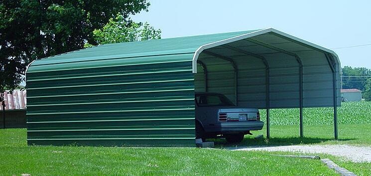 Building a carport like this green single-car model with enclosed sides is easier when you let our pros do it for you